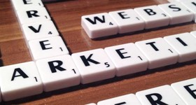 Game of scrabble with the word 'marketing' laid out