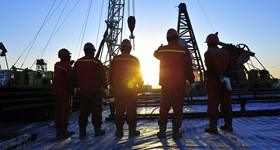 Oil and Gas field workers at drilling rig site